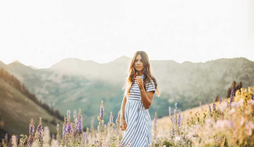 Woman wearing striped dress in field